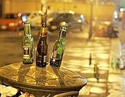 Bottiglie a San Lorenzo dopo il passaggio dei ragazzi del pub crawl