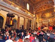 Il pranzo natalizio per i poveri organizzato da Sant' Egidio (foto Ansa)