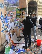 Cittadini al lavoro a Piazza Vittorio (Omniroma)