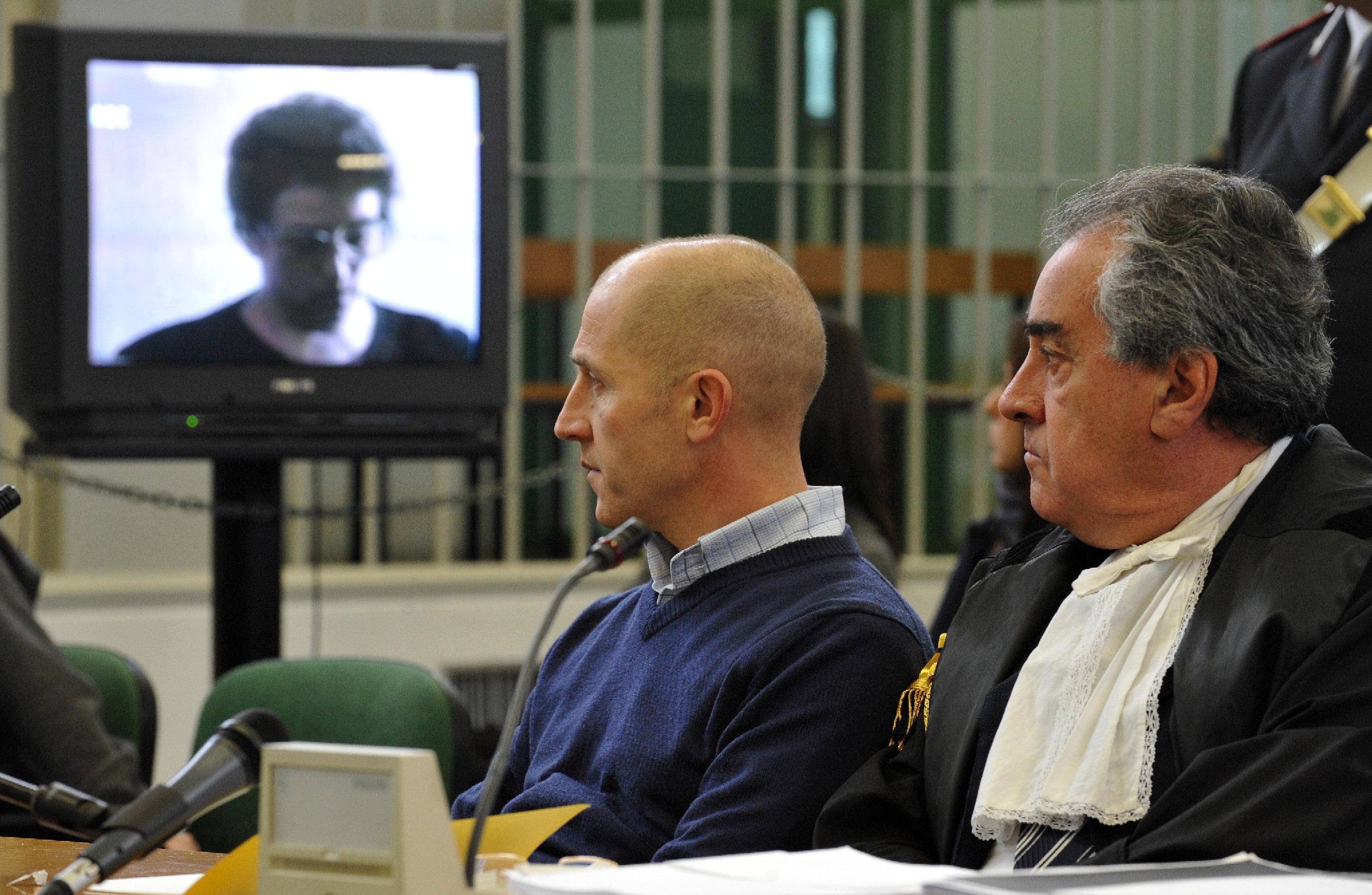 Busco in aula con il suo difensore Paolo Loria (Ansa)
