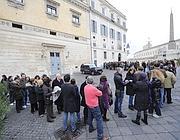 Le code di sabato mattina alla mostra su Caravaggio (foto Ansa)