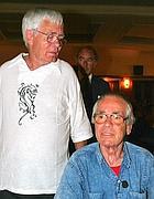 Sergio Citti, seduto, con il fratello Franco (Ansa)