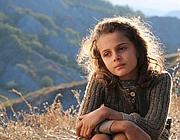 La piccola protagonista del film  'L'uomo che verrà' (foto Ansa)