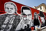 Arte a cielo aperto - Si chiama «Outdoor», ovvero «a cielo aperto» la mostra di arte urbana sui muri di Ostiense che inaugura il 15 giugno. Nella foto i murales in preparazione di JBRock a Via dei Magazzini Generali. (Foto Eidon)