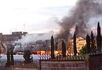 L'incendio - I vigili del fuoco sono  al lavoro da venerdì  sera alle 20 per l'incendio esploso in un capannone della Centrale del Latte di Roma, nella zona di Casal Monastero. L'incendio vero e proprio è stato domato intorno alle 23,30 ma proseguono - probabilmente per tutta la mattina - le operazioni di «smassamento» per evitare che piccoli focolai che covano sotto la cenere possano far riattivare le fiamme. Poco prima delle 20 le fiamme hanno avvolto un capannone, dove venivano custodite le cassette di plastica per trasportare le bottiglie ed i cartoni di latte prima di essere caricati sui camion per la distribuzione ed assemblate delle pedane di legno. Subito si sono formate alte fiamme e colonne di fumo che hanno visto impegnate dodici squadre dei vigili del fuoco e cinque autobotti della Protezione civile del Lazio. L'incendio non ha interessato né l'area della produzione della Centrale del Latte, né abitazioni che distano circa 400 metri. Non ci sono stati feriti. Nel capannone andato a fuoco c'erano anche fusti di ammoniaca e soda caustica che hanno reso più difficili e lunghe le operazioni di spegnimento. Secondo i vigili del fuoco l'area interessata dalle fiamme è stata di 2.700 metri quadrati su complessivi 5000. Ancora imprecisate le cause che hanno provocato l'incendio, in un primo momento si era parlato dalle sterpaglie, ma ancora non è stato confermato, non si esclude l'incendi doloso. Anche la polizia scientifica è al lavoro. E' stata bloccata la produzione del latte, perché il reparto produttivo è stato invaso dal denso fumo nero sprigionato dalle casse di plastica bruciate. (foto Eidon)