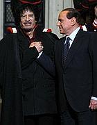 Gheddafi e Berlusconi in occasione dell'ultimo vertice Fao (Ansa)