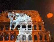 Le proiezioni sul Colosseo per le celebrazioni dei 50 anni dalle Olimpiadi del '60 (Foto Ansa)