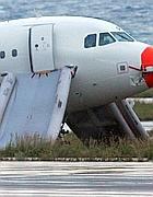 L'aereo della Wind Jet sul prato (Ansa)