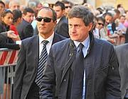 Il sindaco di Roma Gianni Alemanno con il suo ex caposcorta (foto Ansa)