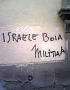 Una delle scritte anti ebraiche a Monti (Omniroma)