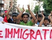 Una protesta di immigrati a Roma (foto Eidon)