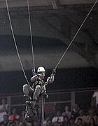 Un attivista di Greenpeace si cala dal tetto dello stadio (Foto Eidon)