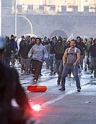 Black bloc a San Giovanni (Ansa)
