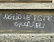 Una scritta su un muro romano (Fotogramma)