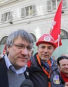 Maurizio Landini, leader della Fiom, in corteo (Ansa)
