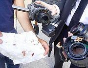 Le Iene mostrano la telecamera distrutta e un fazzoletto con gocce di sangue (Ansa)