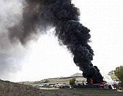 Il deposito d'auto in fiamme (Proto)