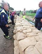 Muri di sabbia per limitare i danni da alluvione (Proto)