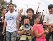 Una manifestazione della comunità cinese a Roma (foto Eidon)