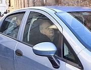 Angelo Rizzoli viene portato via dalla Guardia di Finanza (Ansa)