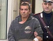 Luigi Preiti esce dal pronto soccorso del san Giovanni per essere condotto nel reparto detenuti del Pertini (Proto)