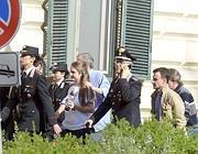 La figlia di Giangrande mentre arriva all'Umberto I con i parenti (Ansa)