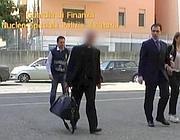 L'arresto di monsignor Scarano in un fermo immagine dal video della Guardia di Finanza