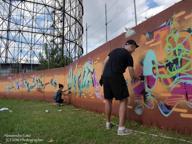Writers dalla Svizzera a Testaccio, graffiti sul muro di cinta del Gazometro